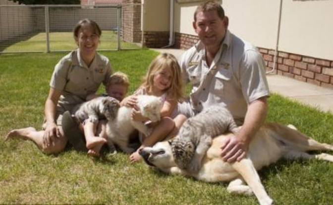 Family with nurturing dog